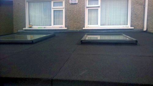 flat roof specialist for residential and commercial roofing